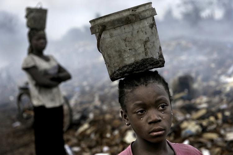 Fati 8 works Ghana's immense eWaste dump (C) Renée C. Byer